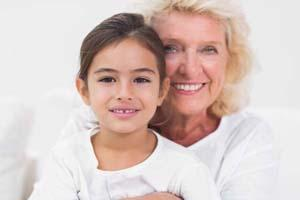 grandmother & grandaughter smiling | dentist new orleans